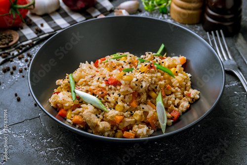 Fototapeta fried rice with chicken , egg and vegetables obraz
