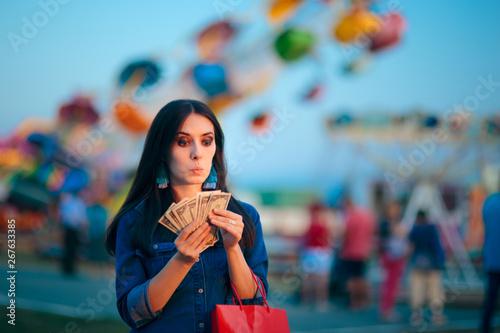 Cuadros en Lienzo Woman Holding Cash Money at Summer Funfair