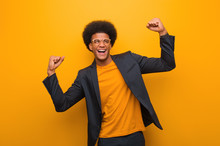 Young Business African American Man Over An Orange Wall Who Does Not Surrender