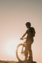 Spain, Lanzarote, Mountain Biker On A Trip At Sunset