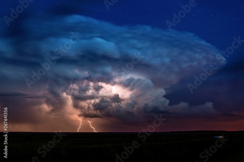 Dramatic sky with cumulonimbus thunderstorm clouds and lightning Canvas-taulu