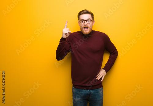 Fotografia, Obraz  Young smart man having an idea, inspiration concept