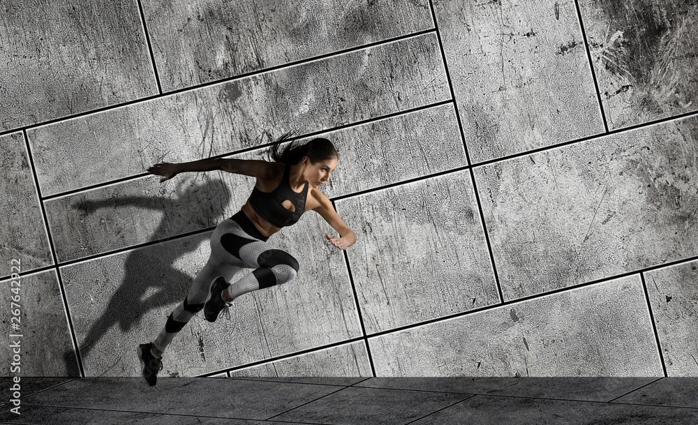 Leinwandbild Motiv - Andrey Burmakin : Woman running on sidewalk. Urban background