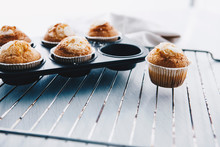 Home-baked Muffins In Muffin Tray On Cooling Grid