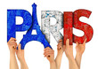 canvas print picture people arms hands holding up wooden letter lettering forming word Paris capital city of france in french national flag colors tourism travel nation concept isolated white background