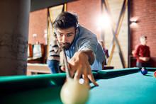 Portrait Of Focused Man Playing Billiards