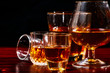 Brandy or liquor,Set of strong alcoholic drinks in glasses and shot glass on dark wood background