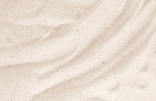 Sand On The Beach As Background. Sand Texture. Brown Sand. Background From Fine Sand.