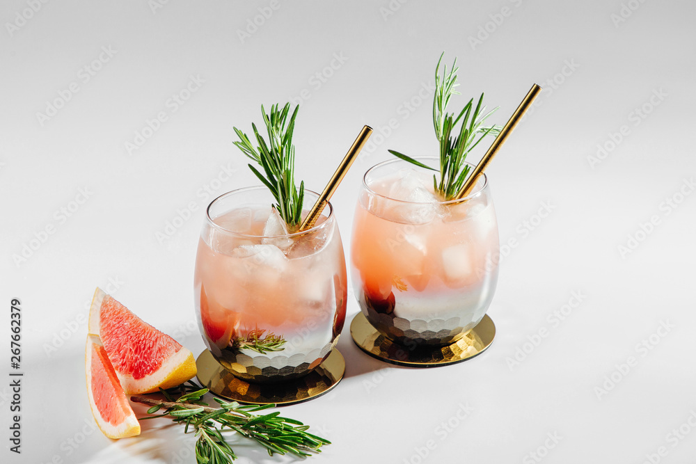 Fototapeta Grapefruit and Rosemary cocktail.  Refreshing and non-alcoholic drink perfect for spring or summer.