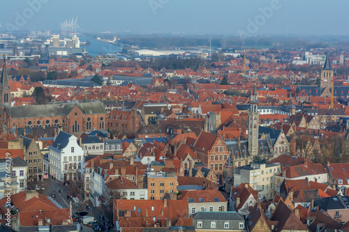 Spoed Foto op Canvas Krakau Fantastic Bruges city skyline with red tiled roofs, The Poortersloge (Burgher's Lodge) tower and windmills in the background. View to Bruges medieval cityscape from the top of the Belfry Tower.
