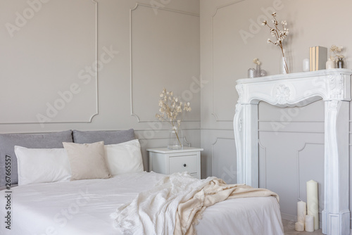 Valokuvatapetti Flowers on white wooden nightstand table in luxury bedroom interior with king si