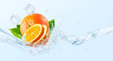 Fresh cold pure flavored water with orange wave splash. Clean orange fruit infused water or liquid fluid wave splash. Healthy flavored detox drink swirl concept with orange slice. 3D