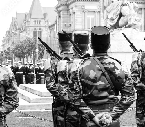 Rear view of soldiers at ceremony to mark Western allies World War Two victory Armistice in Europe marking the 72nd anniversary of victory over Nazi Germany in 1945 black and white Wallpaper Mural