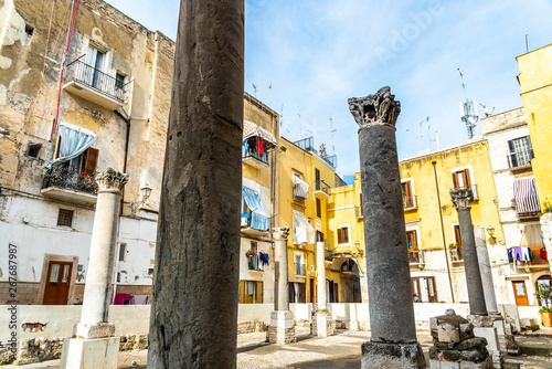 Valokuva  Bari, Italy - March 10, 2019: Ruins of Santa Maria del Buon Consiglio, there are only the remains of the large columns of this old church, among a decadent neighborhood