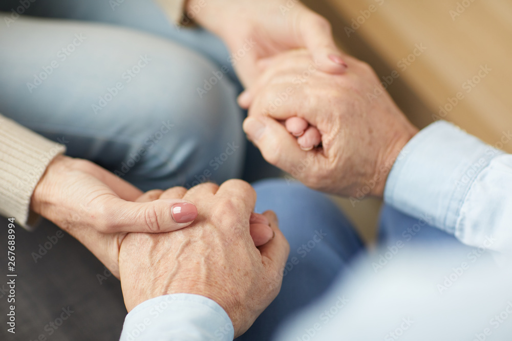 Leinwandbild Motiv - Seventyfour : Closeup of senior couple holding hands supporting each other, copy space