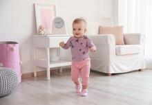 Cute Baby Girl Walking In Room At Home