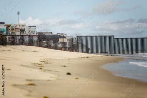 Photo  US Mexican Border Wall Darting Into the Ocean 29