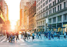 Crowds Of People Walking Across The Busy Intersection Of 23rd Street And 5th Avenue In Midtown Manhattan, New York City