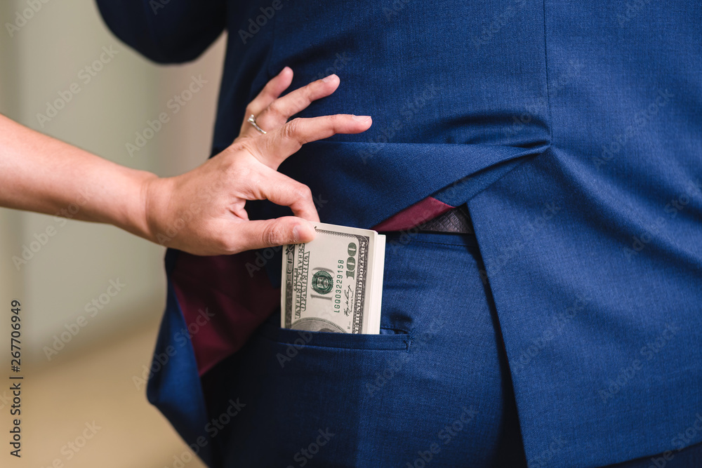 Fototapeta Woman is stealing money from businessman