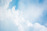 Abstract blurred background Blue sky with white clouds in sunlight. - 267714156