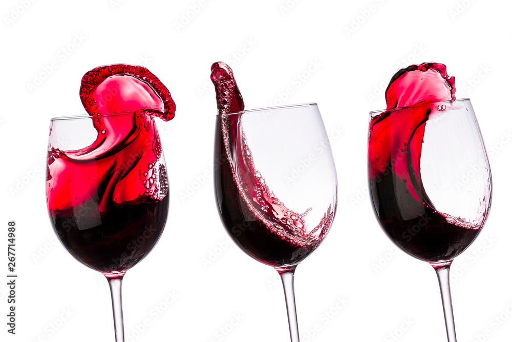 Fototapeta red wine in glasses with splashes on a white background isolated