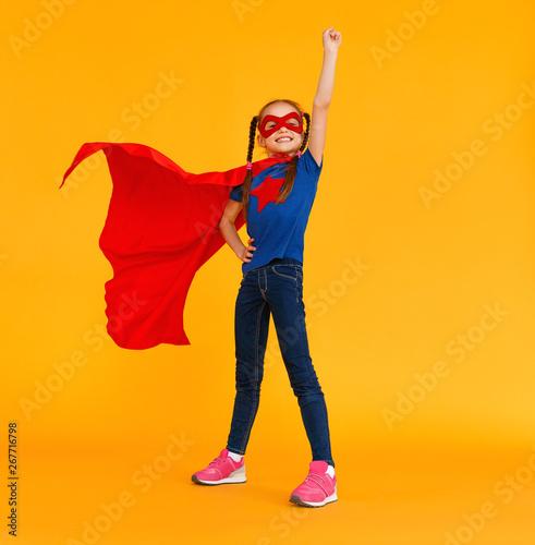 Cuadros en Lienzo concept of child superhero costume on yellow background.