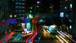 A timelapse of the street at the downtown in Tokyo at night long exposure middle shot tilt