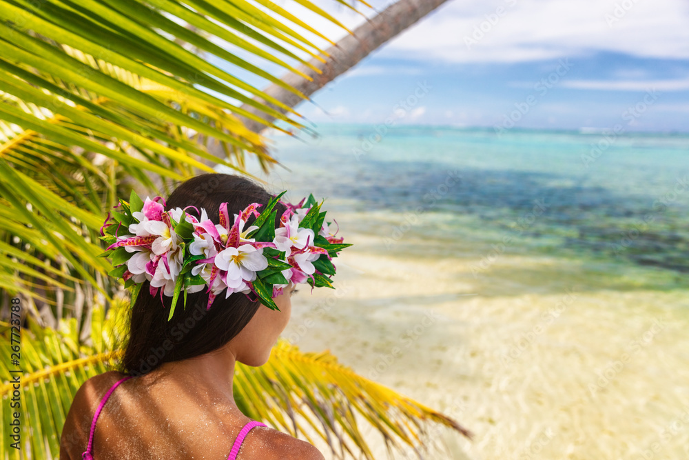 Fototapeta Hawaii beach woman luau dancer relaxing wearing wreath of fresh flowers on Tahiti Bora Bora, French Polynesia.