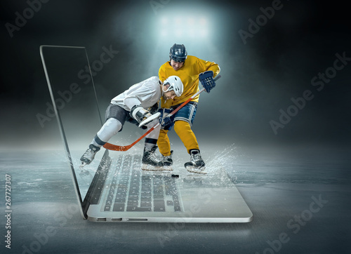 Photo Caucassian ice hockey Players in dynamic action in a professiona