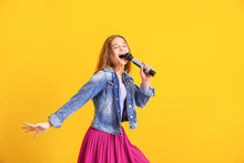 Teenage Girl With Microphone S...