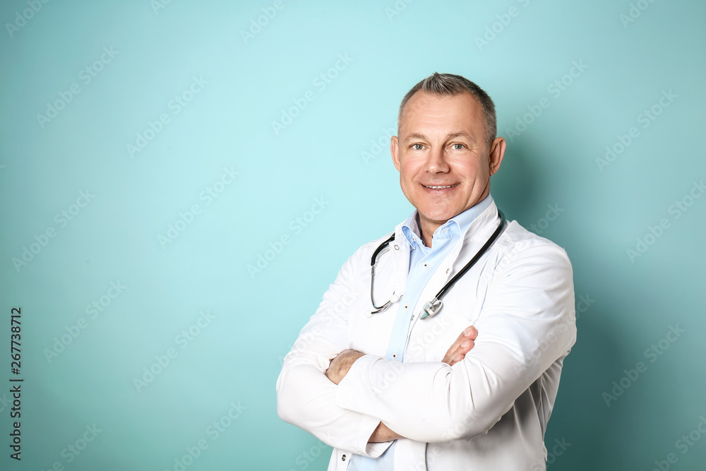 Fototapety, obrazy: Handsome middle-aged doctor on color background