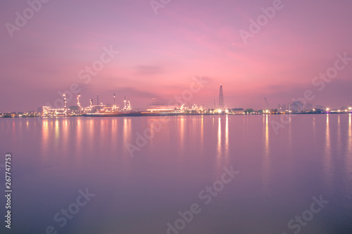Aluminium Prints Dark grey The blurred background of nature along the river, with views of the cargo ship, oil refinery, sunrise and beautiful sky in the morning