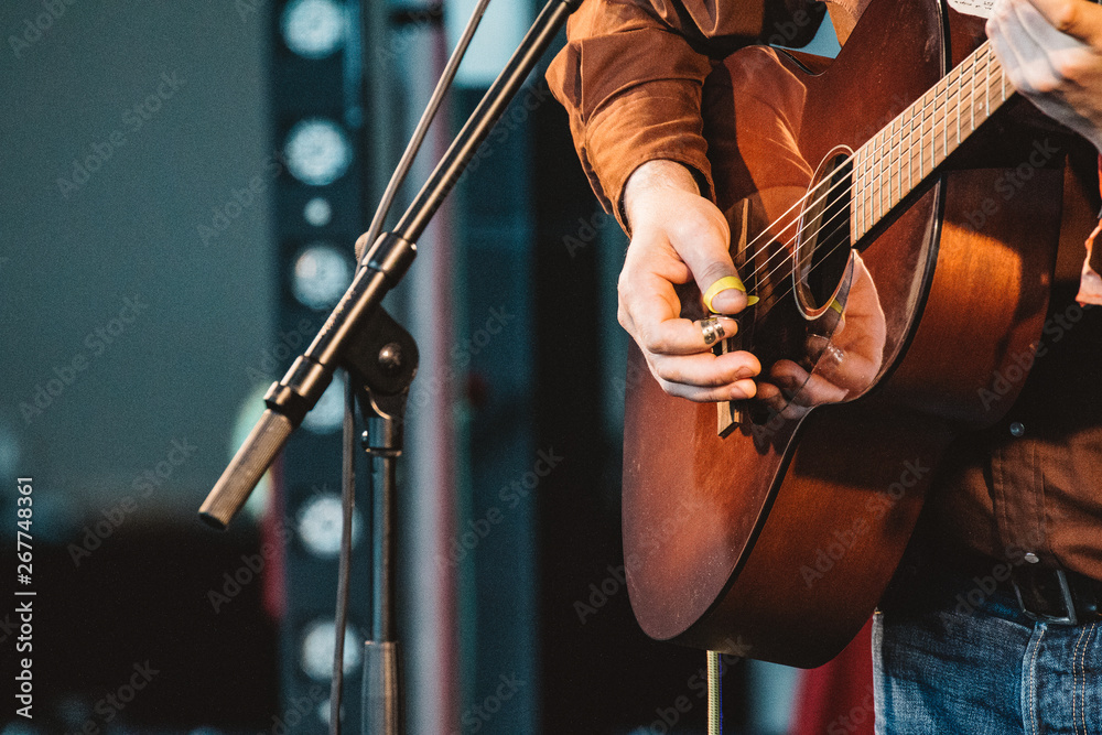 Fototapety, obrazy: GATESHEAD, ENGLAND - JANUARY 22 2015: Norrie McCulloch performs live on the indoor stage at Sage Gateshead's Summertyne Americana Festival 2015
