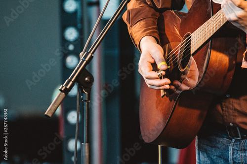 GATESHEAD, ENGLAND - JANUARY 22 2015: Norrie McCulloch performs live on the indoor stage at Sage Gateshead's Summertyne Americana Festival 2015 - 267748361
