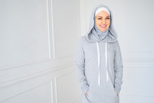 Portrait Of Young Muslim Woman In Gray Hijab And National Fitness Dress At Home, Copy Space.