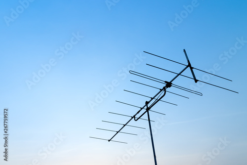 Antenna on blue sky with a copy space for design or text Fototapet