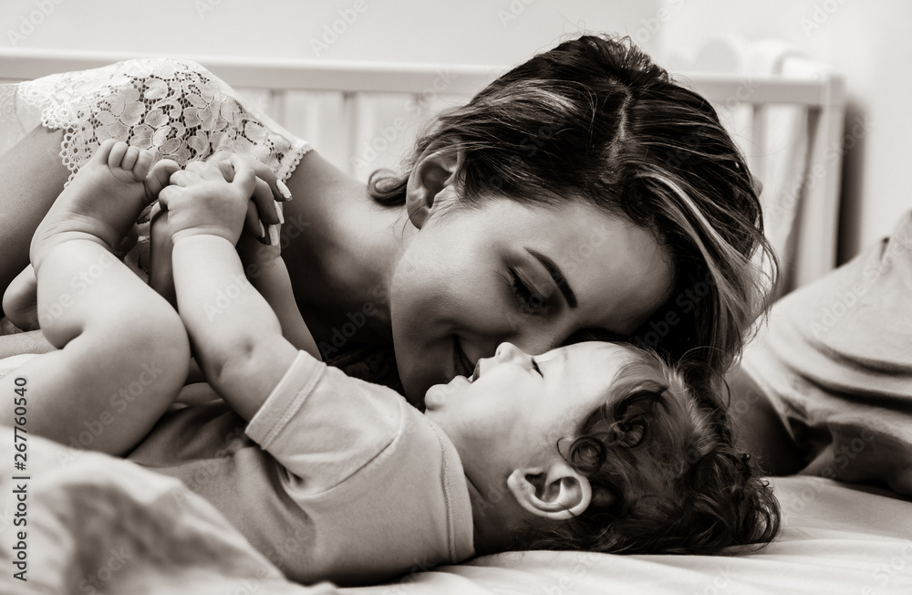 Fototapety, obrazy: Young mother with her 7 month old little son