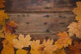 Autumn leaves on rustic wooden background. Top view with copy space. - 267761332