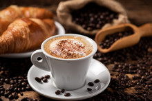 A Cup Of Cappuccino With Coffe...