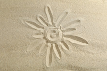Sun Drawing On Clear Sea Sand, Space For Text And Top View. Summer Vacation Background