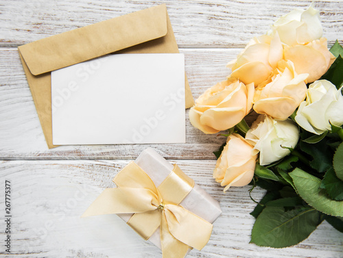 Fototapety, obrazy: White roses and greeting card on a old wooden table