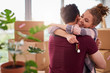 Leinwanddruck Bild - Happy couple with keys of new apartment