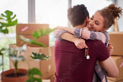 Vászonkép Happy couple with keys of new apartment