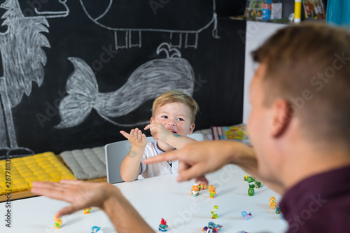 Fototapeta  Cute little playfull toddler boy at speech therapy session
