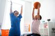 Leinwandbild Motiv Active professional therapist showing right way of training