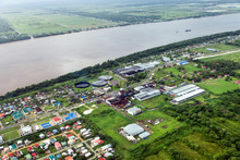 Bird's-eye View Of The Suburbs Of Georgetown And The River Demerara, Rum Factory, Taken From The Plane, Guyana.
