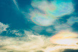 Blue sky with rainbow and white clouds. Summer background - 267804392