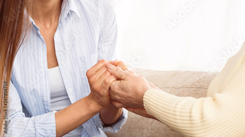 Poster de jardin Individuel Care to senior people. Daughter holding mother hands