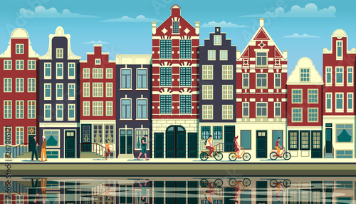 A street in Amsterdam with traditional buildings, walking people and reflections Canvas Print