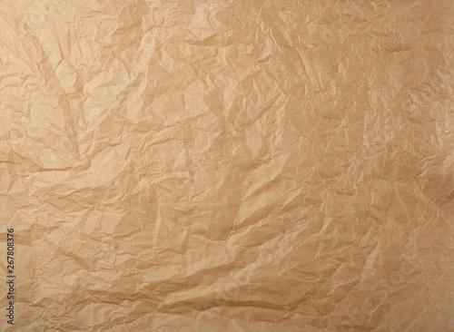 Fototapeta  crumpled brown baking parchment paper